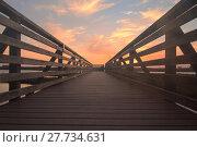 Купить «Wooden Boardwalk at sunset», фото № 27734631, снято 18 июня 2019 г. (c) PantherMedia / Фотобанк Лори