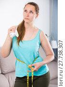 Купить «Woman sad to gain weight», фото № 27738307, снято 21 марта 2017 г. (c) Яков Филимонов / Фотобанк Лори