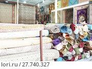 Купить «Heap of rolled up rugs in rug store», фото № 27740327, снято 16 июля 2019 г. (c) PantherMedia / Фотобанк Лори