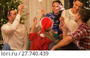 Купить «happy friends celebrating christmas at home party», видеоролик № 27740439, снято 22 декабря 2017 г. (c) Syda Productions / Фотобанк Лори