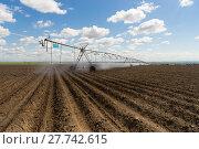 Купить «Center-Pivot Irrigation Waterwheel Circle Irrigator Farm Field Agriculture», фото № 27742615, снято 15 августа 2018 г. (c) PantherMedia / Фотобанк Лори