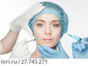 Купить «Attractive woman at plastic surgery with syringe in her face», фото № 27743271, снято 19 сентября 2018 г. (c) PantherMedia / Фотобанк Лори