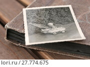 Купить «old photo album,closed and old photo», фото № 27774675, снято 22 октября 2018 г. (c) PantherMedia / Фотобанк Лори