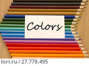 Купить «Blank white paper and colored pencil on wooden background», фото № 27778495, снято 18 февраля 2020 г. (c) PantherMedia / Фотобанк Лори