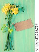 Купить «Freesia flowers with blank tag», фото № 27783739, снято 15 сентября 2019 г. (c) PantherMedia / Фотобанк Лори