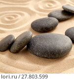 Купить «Close up of zen garden with group of black stones», фото № 27803599, снято 13 ноября 2018 г. (c) PantherMedia / Фотобанк Лори
