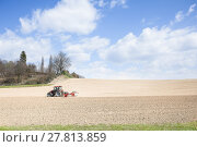 Купить «Tractor compresses the soil after planting with rollers.», фото № 27813859, снято 19 марта 2019 г. (c) PantherMedia / Фотобанк Лори