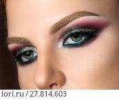 Купить «Close up of blue woman eyes with fashion makeup», фото № 27814603, снято 2 июля 2017 г. (c) Людмила Дутко / Фотобанк Лори