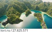 Купить «Coron, Palawan, Philippines, aerial view of beautiful Twin lagoon and limestone cliffs. Fisheye view.», видеоролик № 27825571, снято 5 февраля 2018 г. (c) Mikhail Davidovich / Фотобанк Лори
