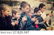 Купить «children with mobile devices», фото № 27829347, снято 7 июля 2020 г. (c) Яков Филимонов / Фотобанк Лори