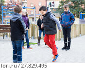 Купить «Kids skipping on chinese jumping elastic rope in yard», фото № 27829495, снято 15 мая 2018 г. (c) Яков Филимонов / Фотобанк Лори