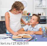 Купить «Sister is helping brother with homework», фото № 27829511, снято 7 августа 2017 г. (c) Яков Филимонов / Фотобанк Лори