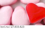 Купить «close up of pink heart shaped candies», видеоролик № 27833823, снято 10 февраля 2018 г. (c) Syda Productions / Фотобанк Лори