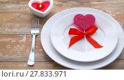 Купить «close up of red heart shaped lollipop on plate», видеоролик № 27833971, снято 10 февраля 2018 г. (c) Syda Productions / Фотобанк Лори