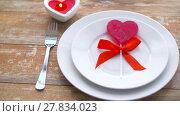 Купить «close up of red heart shaped lollipop on plate», видеоролик № 27834023, снято 10 февраля 2018 г. (c) Syda Productions / Фотобанк Лори
