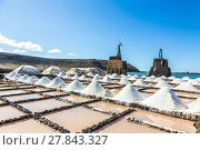 Купить «salt piles in the saline of Janubio in Lanzarote with old toteen wind mill», фото № 27843327, снято 19 ноября 2018 г. (c) PantherMedia / Фотобанк Лори