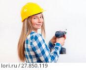 Купить «Young woman doing the DIY work and wearing protective helmet», фото № 27850119, снято 22 июля 2019 г. (c) easy Fotostock / Фотобанк Лори