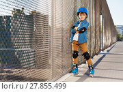 Купить «Cute roller skater in helmet at outdoor rollerdrom», фото № 27855499, снято 14 октября 2017 г. (c) Сергей Новиков / Фотобанк Лори