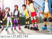 Купить «Happy friends rollerblading together at sunny day», фото № 27855743, снято 14 октября 2017 г. (c) Сергей Новиков / Фотобанк Лори