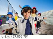 Купить «Preteen boy rollerblading with friends outdoors», фото № 27855791, снято 14 октября 2017 г. (c) Сергей Новиков / Фотобанк Лори