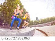 Купить «Athletes performing jumps during functional train», фото № 27858063, снято 23 сентября 2017 г. (c) Сергей Новиков / Фотобанк Лори
