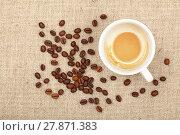 Купить «Latte cappuccino cup and coffee beans on canvas», фото № 27871383, снято 20 октября 2018 г. (c) PantherMedia / Фотобанк Лори