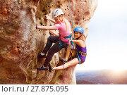 Купить «Rock climbers reaching the summit of a mountain», фото № 27875095, снято 28 октября 2017 г. (c) Сергей Новиков / Фотобанк Лори