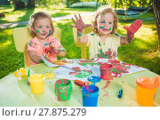 Купить «Two-year old girls painting with poster paintings together against green lawn», фото № 27875279, снято 25 июня 2019 г. (c) PantherMedia / Фотобанк Лори