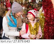 Купить «Happy woman with small daughter in market», фото № 27879643, снято 21 сентября 2018 г. (c) Яков Филимонов / Фотобанк Лори