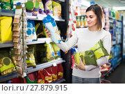 Купить «woman choosing delicious snacks in supermarket», фото № 27879915, снято 23 ноября 2016 г. (c) Яков Филимонов / Фотобанк Лори