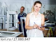 Купить «Female supervisor checking quality of work», фото № 27880847, снято 19 июля 2017 г. (c) Яков Филимонов / Фотобанк Лори