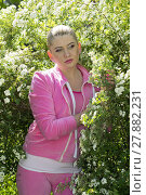 Купить «the beautiful woman in a pink suit in the blossoming bush», фото № 27882231, снято 26 марта 2019 г. (c) PantherMedia / Фотобанк Лори