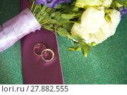 Купить «Delicate Wedding background with Rings and Buttercup Flower», фото № 27882555, снято 20 марта 2019 г. (c) PantherMedia / Фотобанк Лори