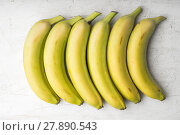 Купить «Yellow bananas are laid out in a rectangle», фото № 27890543, снято 26 мая 2018 г. (c) PantherMedia / Фотобанк Лори