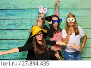 Купить «girl group with hats and bunny ears - party with photo booth», фото № 27894435, снято 24 февраля 2018 г. (c) PantherMedia / Фотобанк Лори