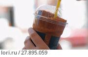 Купить «Woman drinking chocolate cocktail with straw», видеоролик № 27895059, снято 22 мая 2019 г. (c) Данил Руденко / Фотобанк Лори
