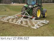Купить «harrow and tractor - agriculture in use», фото № 27896027, снято 27 марта 2019 г. (c) PantherMedia / Фотобанк Лори