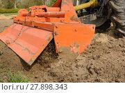 Купить «milling machine loosens soil», фото № 27898343, снято 23 марта 2019 г. (c) PantherMedia / Фотобанк Лори
