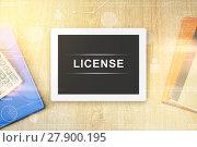 Купить «license word on tablet», фото № 27900195, снято 22 июня 2018 г. (c) PantherMedia / Фотобанк Лори