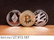Three coins bitcoin ligtecoin ethereum. Стоковое фото, фотограф Anton Chechotkin / Фотобанк Лори