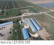Купить «Hangar of galvanized metal sheets for storage of agricultural products», фото № 27915107, снято 18 января 2019 г. (c) PantherMedia / Фотобанк Лори