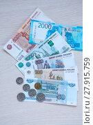 Купить «Russian paper money and coins lie on the table», фото № 27915759, снято 15 февраля 2018 г. (c) Катерина Белякина / Фотобанк Лори