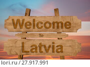 Купить «welcome to latvia sign on wood background with blending national flag», фото № 27917991, снято 20 июня 2019 г. (c) PantherMedia / Фотобанк Лори