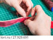 Купить «craftsman stitches new leather belt close up», фото № 27929691, снято 22 марта 2019 г. (c) PantherMedia / Фотобанк Лори
