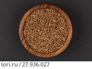 Купить «Coriander seeds in  small wooden bowl», фото № 27936027, снято 18 марта 2019 г. (c) PantherMedia / Фотобанк Лори