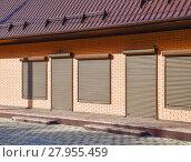 Купить «The roof of corrugated sheet on a building», фото № 27955459, снято 26 мая 2019 г. (c) PantherMedia / Фотобанк Лори