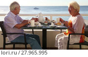 Breakfast at the hotel. Senior couple enjoying their summer vacation. Стоковое видео, видеограф Алексей Кузнецов / Фотобанк Лори