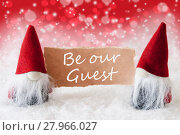 Купить «Red Christmassy Gnomes With Card, Text Be Our Guest», фото № 27966027, снято 26 марта 2019 г. (c) PantherMedia / Фотобанк Лори