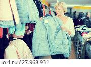 Купить «Mature woman buyer choosing windbreaker jacket», фото № 27968931, снято 20 декабря 2017 г. (c) Яков Филимонов / Фотобанк Лори