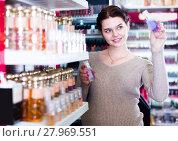 Купить «woman customer deciding on perfume variants in cosmetics shop», фото № 27969551, снято 21 февраля 2017 г. (c) Яков Филимонов / Фотобанк Лори